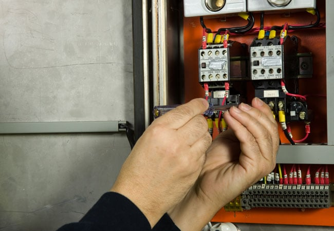electrician working on fuses