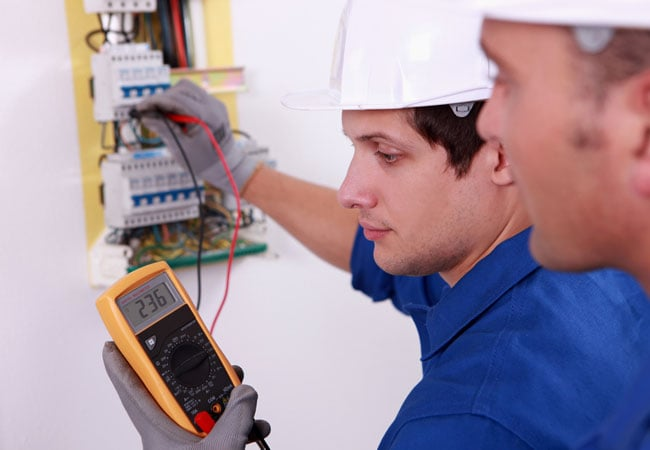 electrician reading a meter